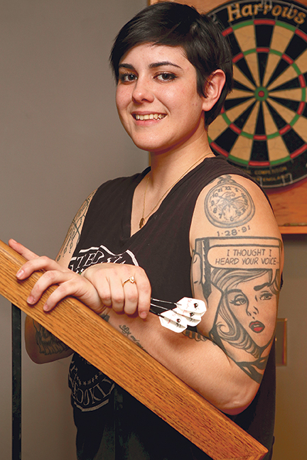 Ashle Vanelli is 25 and has 22 tattoos. She plays in an amateur dart league and is pictured in her Syracuse apartment. Michael Davis photo